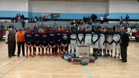 Southern Lee and Overhills basketball players pose with their donations to Toys for Tots campaign prior to their game.